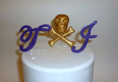 cake topper... no skull and crossbones but something fun...