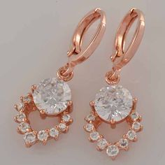 9k rose gold-filled cz dangly heart earrings - 29mm x 11mm @ AUD$12.00 + postage or local pick up available.