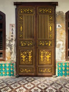 Wooden door with gold ornaments, Penang, Malaysia - 2014