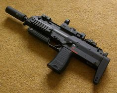 Smaller than a conventional submachine gun, the 4.6 mm  MP7A1  is a compact and lightweight Personal Defense Weapon that can be carried lik...