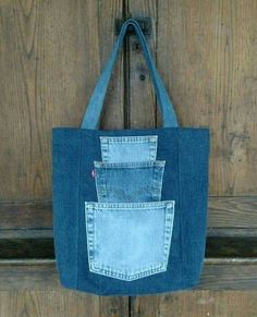 Pick a Pocket Tote Bag. Sturdy yet stylish, this large one-of-a-kind tote bag . Pick a Pocket Tote Bag. Sturdy yet stylish, this large one-of-a-kind tote bag will soon become your trusted compan Denim Tote Bags, Denim Handbags, Denim Purse, Jean Purses, Purses And Bags, Diy Sac, Blog Couture, Denim Crafts, Recycled Denim