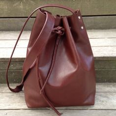 A simple square bottom tote turned bucket bag.