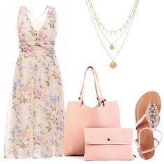 Una proposta fresca e delicata, per le amanti dello stile romantico. Il vestito al ginocchio, con scollo a V in una delicata fantasia floreale sui toni del rosa, ha la schiena scoperta. I sandali gioiello flat, in modello infradito e la borsa sono rosa mentre la delicata collana multifilo è dorata.
