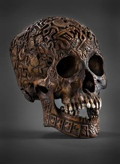 An engraved human skull from Tibet said to lift a family curse or guide a mislead soul.