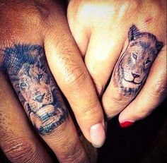 Lion and lioness tattoo designs on finger.