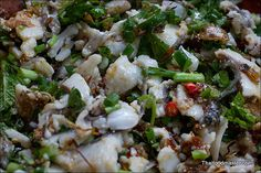 Luang Prabang Style Koi Fish Salad Recipe || One piece of tilapia fillet, 1 tablespoons shallots. 2 large cloves of garlic, 1 stalks of lemongrass, 3 stalks of lemongrass, 3 birds eye chilies, 1 tablespoon roasted rice powder. 1 tablespoon fish sauce or fermented fish sauce 1 tablespoon lime juice ¼ cup spring onions, chopped ¼ cup coriander leaves, 3 tablespoons of mint leaves,