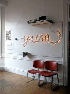 """""""Neon lighting can be expensive - so why not create your own neon-style light with a few pin nails and string lights!"""""""
