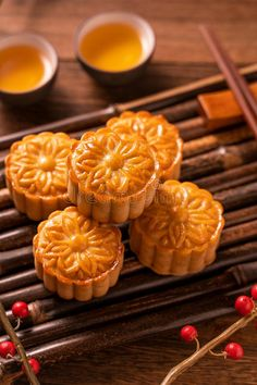 Moon cake Mooncake table setting - Round shaped Chinese traditional pastry with tea cups on wooden background, Mid-Autumn Festival. Photo about festival, close, east - 154581948 Cake Festival, Food Festival, Chinese Moon Cake, Mooncake Recipe, Yakisoba, Eat Happy, Almond Cookies, Cafe Food, Aesthetic Food