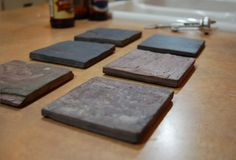Coasters for the home and office. Cork bottomed, these drink coasters will look great in any home. Use the included chalk to write your name or drink order for the wife. Made from heavy slate which is a REAL material, not just a kitchen tile with a piece of cork on the bottom.    Simple, minimal,...