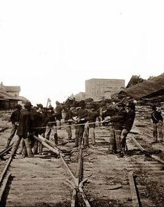 Atlanta, Georgia… Sherman's Men Tearing Up Railroad Track. Photographed in 1864 by Barnard