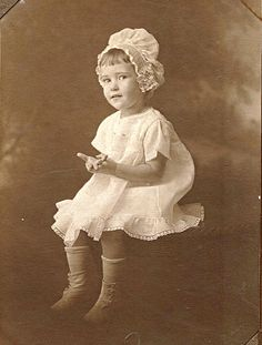 Sweet little girl in a bonnet.  This is thought to be Margaret Hollingsworth, owner of Hollingsworth Feed for many years.