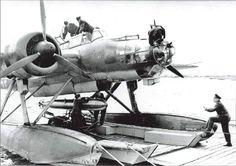 A Heinkel He115 having a torpedo installed before flight operations