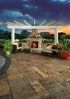 This pergola and fireplace combo is stunning!