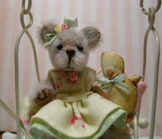 Miniature bear with duckie