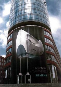 Great idea for an architectural building wrap. Look at de revolving doors. #excelenciaip