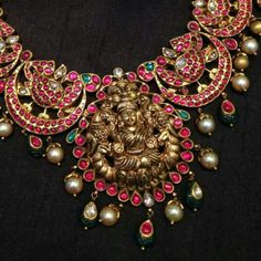 Heritage neckset with peacocks on the side and laxmi at the center...from https://m.facebook.com/najjewellery