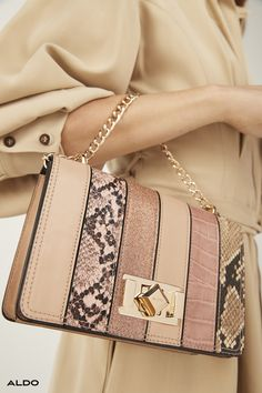 For the girls that prefer a side of glamour with their day, this mid-sized handbag from Aldo Shoes is distinguished by luxuriously exotic-animal embossed stripes and shiny hardware. Features a turn-lock closure and pocket lined interior to keep your essentials safe and in place.