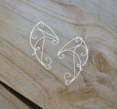 These ear cuffs are made with silver plated copper core wire.  These are great for Halloween! They are unlike any ear cuffs that I have added to my
