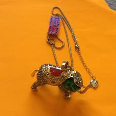 Betsey Johnson Elephant Necklace NWT Gold elephant with gold chain 16 inches long with chain.  elephant has diamond jewels and a green ear with gold and red on his back. Betsey Johnson Jewelry Necklaces
