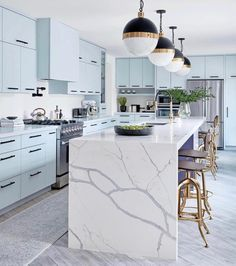 Pendants are such a beautiful addition to any space in your home. In much the same way as chandeliers, they add drama, interest, and elegance. However, if they are hung too low or too high, they can throw the room off balance and look out of place. Kitchen Cabinet Colors, Kitchen Colors, Glass Cabinet Doors, Contemporary Home Decor, Visual Comfort, Cuisines Design, Kitchen Flooring, Mid-century Modern, Industrial