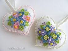 Felt and beaded flowers on a heart