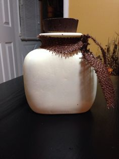 Cream jar with brown burlap