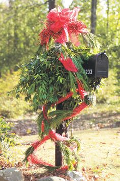 Drape Your Mailbox - Wrap sheer ribbon loosely around a pine garland and drape the garland around the mailbox. Wire clusters of bright nandina berries to the top of the post, and finish with a big bow for an eye-catching Christmas flourish.
