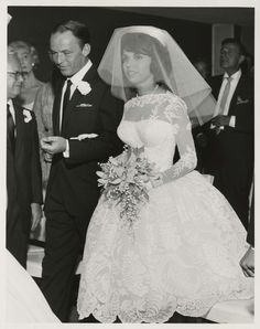 "Photograph of Frank Sinatra walking his daughter, Nancy Sinatra, down the aisle at the Sands Hotel in Las Vegas, September 11, 1960. Photograph is part of the UNLV Libraries ""Photo"" digital collection."