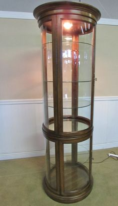 Exceptional ROUND GLASS LIGHTED CURIO CABINET, DISPLAY, SHELVES, By GORDON FURNITURE