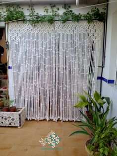 Cortina macramé modelo hojas arco blanco