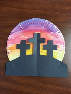 Black crosses and paper plate sunset