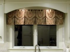 love the window treatment & curved detail for above the kitchen sink