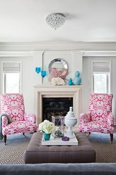 Gray living room + pink ikat chairs: Benjamin Moore 'Classic Gray'    Walls are painted Classic Gray by Benjamin Moore.    Photo from High Gloss magazine.