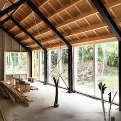 exposed (powdercoated) steel rafters, wood joists and roof sheathing weave a romantic pattern and warm accent contrast. exposed (powdercoated) steel rafters, wood joists and roof sheathing weave a romantic pattern and warm accent contrast. Metal Barn Homes, Pole Barn Homes, Steel Frame House, Steel House, Roof Sheathing, Modern Barn House, Prefab Cabins, Cabin In The Woods, Shed Homes