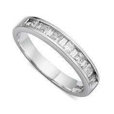 This beautiful band features alternating princess cut and baguette cut diamonds totaling 1/2 of a carat; they are channel-set in a 14k white gold mounting. This ring is a perfect wedding band for the woman who want simple and elegant.