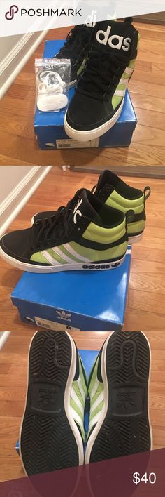 Men's high top Adidas sneakers In excellent condition , wore a handful of times. My husband just has way to many sneakers to choose from. Black, lime green and white adidas high top sneakers. Also comes with white interchangeable shoe laces Adidas Shoes Athletic Shoes