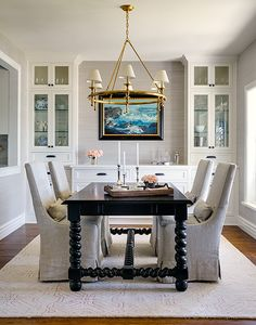 opened up the wall between the kitchen and dining room to bring in more light to the kitchen and designed built-in cabinetry to display my clients china and collectibles. P.S. my clients have a beautiful view of the ocean out the windows. . . Heaven! — Marianne Simon Design