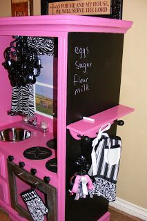 repurpose an old entertainment center into the coolest kitchen ever for a little girl.