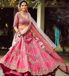 The ornate skirt-like outfit worn by most Indian brides for their big day ceremony is known as the Bridal Lehenga #lehenga #saree #lehengacholi #fashion #indianwedding #indianwear #ethnicwear #wedding #indianfashion #indianbride #bridallehenga #onlineshopping #kurti #lehengalove #bridalwear #weddingdress #designerlehenga #designer #lehengas #bridal #weddinglehenga Pakistani Bridal Hairstyles, Pink Lehenga, Lehenga Designs, Fashion Games, Image Now, Wedding Season, Bridal Style, Ball Gowns, Sari