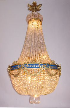 A Fine and Large French Empire Style 19t/20th Century Gilt-Bronze and Cut-Glass Prisms Cascade Fourteen-Light Chandelier. #lights #lighting #decor