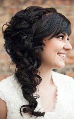 Love the cascading curls over one shoulder. This hairstyle is delicate, romantic, & perfect for any wedding. #weddinghair #curls #hairstyles #Mesonista | Mesonista