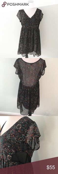 "UO ecote Black floral Baby doll Dress short sleeve Excite dress from Urban Outfitters. Lined body with sheer sleeves and back and sides. . Black with floral print. So pretty! Size large. Chest 20.5"". Length 33.5"". Buttons on front. Urban Outfitters Dresses"