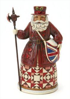British Santa--Father Christmas Grants Winter Wishes-British Santa Figurine. A customary British Santa with staff and a Union Jack bag. Part of Santa's Around The World Collection.