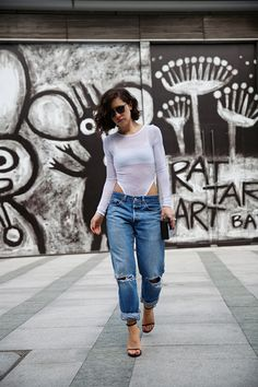 Wearing a Cheap Monday knit bodysuit, vintage Levi 501s, Saint Laurent sandals, Super sunglasses, and Nadia Gabriella clutch.
