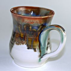 """I love coffee mugs.  Love the glaze on this one.  I """"collect"""" unusual mugs of the hand-thrown nature."""