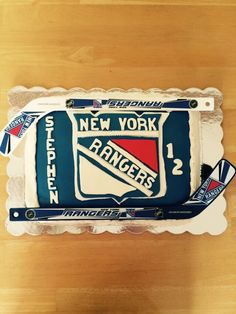 NY Rangers cake for grandson's 12th birthday. Everything edible except hockey sticks.