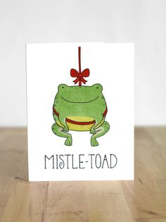 Mistle-Toad. Mistletoe. Toad. Frog. Christmas. XMas. Pun. Blank Card. Illustration and Lettering. 100% Percent Recycled Paper.