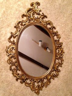 Vintage Burwood Ornate Oval Wall Mirror; Hollywood Regency; victorian vintage large, gold oval wall mirror from Burwood products dated 1964.
