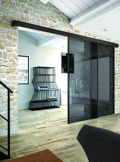 smoked glass sliding doors stand out in stone clad giving it a fresh and more modern look Sliding Door Design, Sliding Closet Doors, Glass Door Lock, Sliding Glass Door, Layout Design, Living Room Divider, Glass Partition, Minimalist Room, Futuristic Furniture