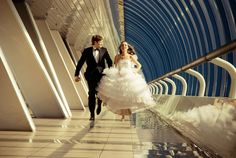 I love this idea for a wedding photograph! Like the bride and groom are running away together. Must do this.
